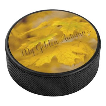 Yellow autumn maple leaves. Add text. Hockey Puck