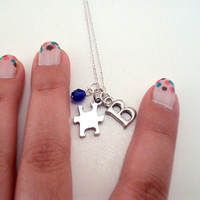 Puzzle piece best friend necklace. One puzzle necklace with custom initial and glass bead. Silver pewter puzzle piece, Czech glass bead.