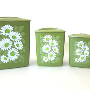 vintage set of 3 kitchen canister tins with flowers / green with daisies plastic containers