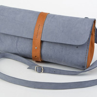 Handmade two-colored genuine leather clutch bag styled on denim for women
