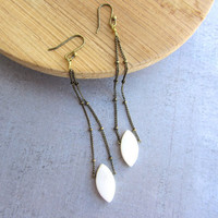Brass and oval shell long dangle earrings with beaded chain.
