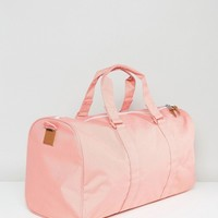 Herschel Supply Co. Ravine Holdall in Strawberry Ice at asos.com