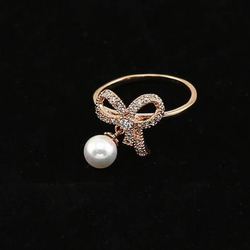TrinketSea Trendy Bowkont Pearl Metal Statement Band Rings Women Costume Wedding Party Fashion Jewelry Ring Glass Cubic Zirconia