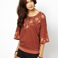 Free People Top with Floral Embroidery and Bell Sleeves