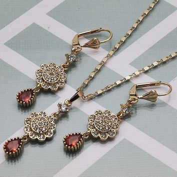 Gold Layered Women Flower Earring and Pendant Adult Set, with Garnet Cubic Zirconia, by Folks Jewelry