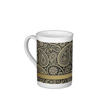 Gold Paisley on Black Background with Gold Ribbon Bone China Mugs from Zazzle.com