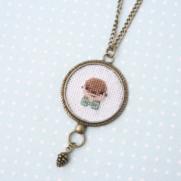 Cute otter cross stitch necklace
