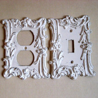 Light and plug cover switchplate set in vintage brass painted with an antique white chippy paint finish, ornate rose detailing