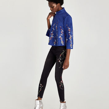 THE SKINNY JEANS WITH FLORAL EMBROIDERY