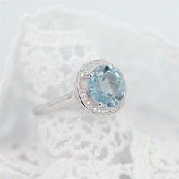 Magic Pieces Sterling Silver Ring with Big Round Natural Blue Topaz and CZ J1122