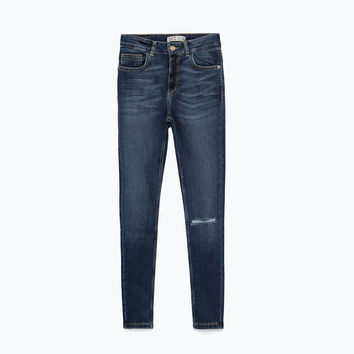 Cropped jeans with knee seam