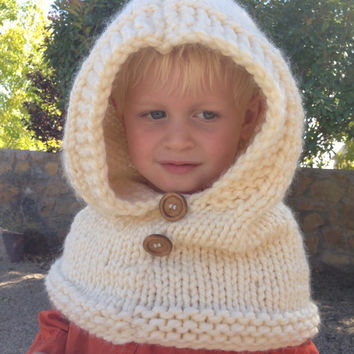 Cowl hooded . Hand knitted. Super bulky yarn. Fits toddlers child 5-8 years old. Very bulky and warm. Winter accessories.