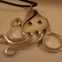 A Spoon Rings Plus Beautiful Fork Octopus Necklace Pendant on a black Cord Spoon an Fork Jewelry o22