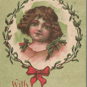Green Irish Girl donning Holly Leaves & Berries for Christmas framed with Mistletoe Vintage Postcard