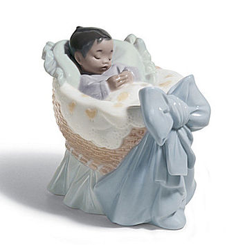 Lladro A New Treasure Boy Dark Skin Figurine