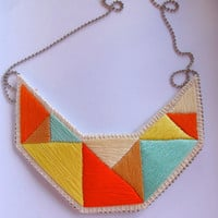 Geometric bib necklace in mint bright yellows tan and orange embroidered triangles dramatic design