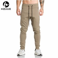 HZIJUE 2017 New Gyms Mens Joggers Skinny Sweat Pants Embroidery Tights Sweatpants For Men Side Zipper Sheer Trouser pant