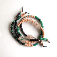 Long beaded necklace with plum, peach, and green glass beads with Ghanian and Ethiopian beads Fall fashion