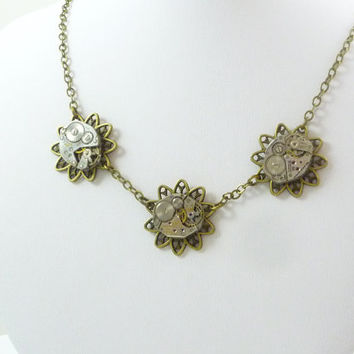 Steampunk Neo-Victorian Necklace with Vintage Watch Movements on Flower Filigree Pendant by VictorianFolly
