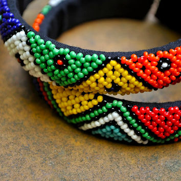 Pair of African cuff bracelets (beaded, traditional pattern, bangles)