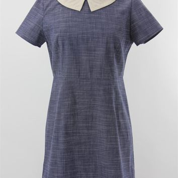 Featuring a Peter Pan Collar with single button closure, navy/white combo chambray fabrication, short sleeves, slit back with hidden zipper closure. Unlined.