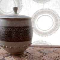 Patterned stoneware covered jar in gray and brown