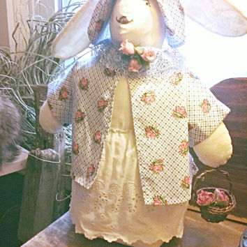 "Stuffed Easter Bunny approx. 11"" High. Dressed in Cotton Eyelet with a Floral Jacket. Embellished with Silk Roses and Holding a Basket."