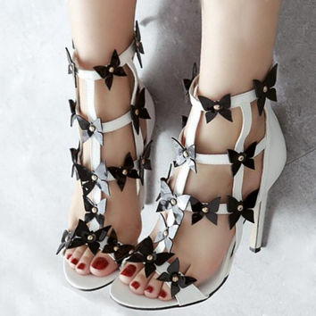 White Cut Out Zipperred Sandals