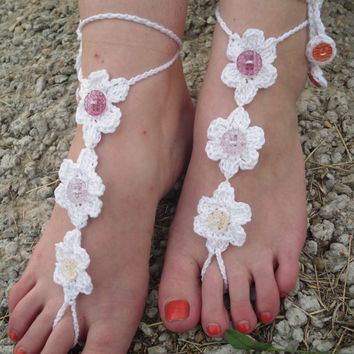 White crochet handmade barefoot sandals with buttons. beach and wedding shoes, foot jewelry