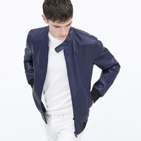 White-lined faux leather jacket
