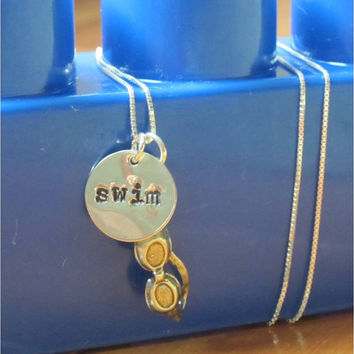 "Sterling silver swimming necklace with hand stamped ""swim"" charm with silver swim goggles and chain"
