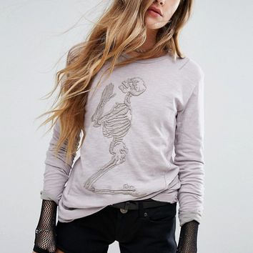Religion Long Sleeve Top With Embroidered Skeleton at asos.com