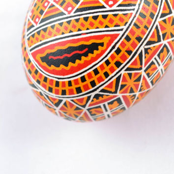 Handmade ethnic Easter egg painted with acrylics ornaments interior decor ideas