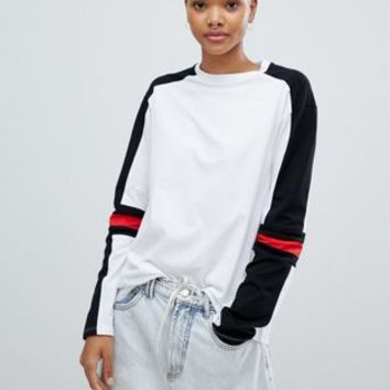 ASOS DESIGN long sleeve t-shirt in mono colour block at asos.com