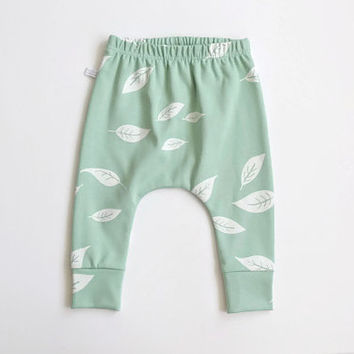 Baby infant harem pants with leaves in mint. Slim fit harem pants with cuffs. Interlock jersey knit (Öko-Tex Standard 100).  Infant pants