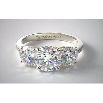 A Colorless 3TCW Three Stone Journey Moissanite Diamond Ring