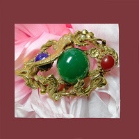 Exotic jade green dragon brooch. UNSIGNED