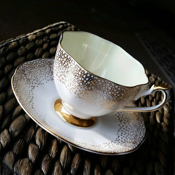 Antique Queen Anne white and gold scalloped tea cup and saucer, bone china English tea set