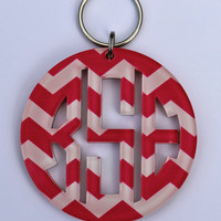 Adorable acrylic monogrammed keychains made in hot pink and white chevron