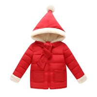 Children's winter clothes in a cute Christmas cap coat