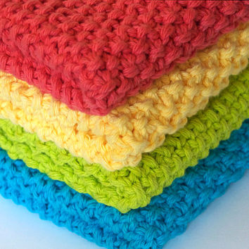 hand knit plushy cotton washcloths, set of four in bright coral, yellow, hot lime, and bright blue