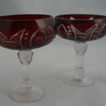 Pair of stemmed bon-bon dish in flashed ruby glass cut to clear. Attractive hand cut naive pattern. Vintage home decor