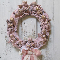 Shabby chic plaster cherub wall wreath hand painted painted and distressed embellished home decor Anita Spero