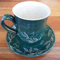 Mug and saucer- dark green stoneware leaves and vines incised sgraffito