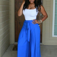 White Strappy Top and Blue Pants