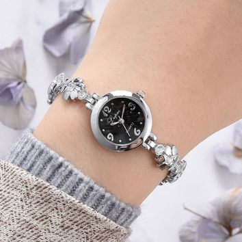 Aimecor Hollow Music Note Stainless Steel Womens Quartz Wristwatch