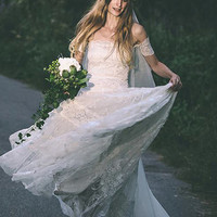 Bohemian strapless wedding dress featuring stunning arm bands and amazing lace panelled skirt