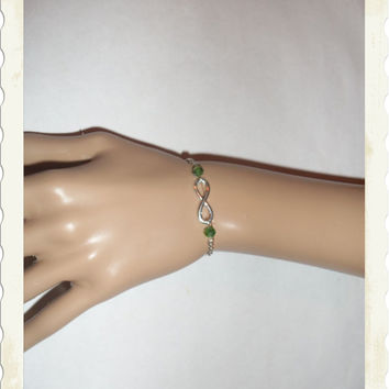 Silver infinity bracelet with green Swarovski crystals bridesmaid gift for wedding