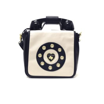 Now you're talking. Stand out from the crowd with this Ring Me Phone crossbody bag, featuring a retro phone headset that plugs into any cell phone. Fashioned in smooth faux leather with gilded detailing, it's perfectly sized for chic on-the-go style. Faux