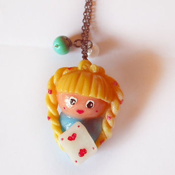 Alice in Wonderland necklace with hearts card with beads made entirely by hand in cold porcelain